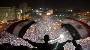 Anti-Mursi protesters chant slogans during a mass protest to support the army in Tahrir square, Cairo