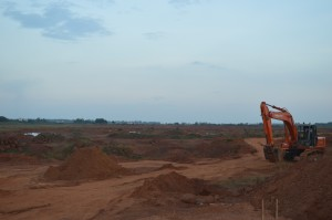 Thondaimani Lake in front of the SIPCOT complex is almost lost as earth movers are preparing the plot for construction